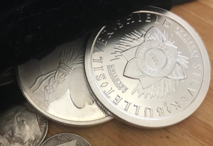 Silver Rounds Coming Out of Bag